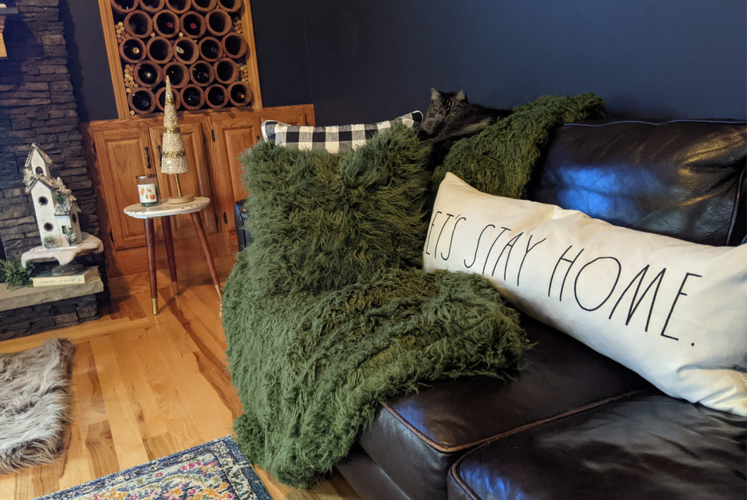 green curly faux fur pillow for luxury living. includes insert in boho living room
