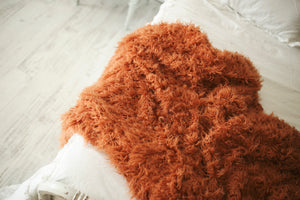 pumpkin orange, halloween, faux fur sheepskin blanket on bed