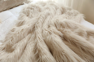 double sided, luxury, faux fur blanket on white bed. thick and incredibly warm winter blanket