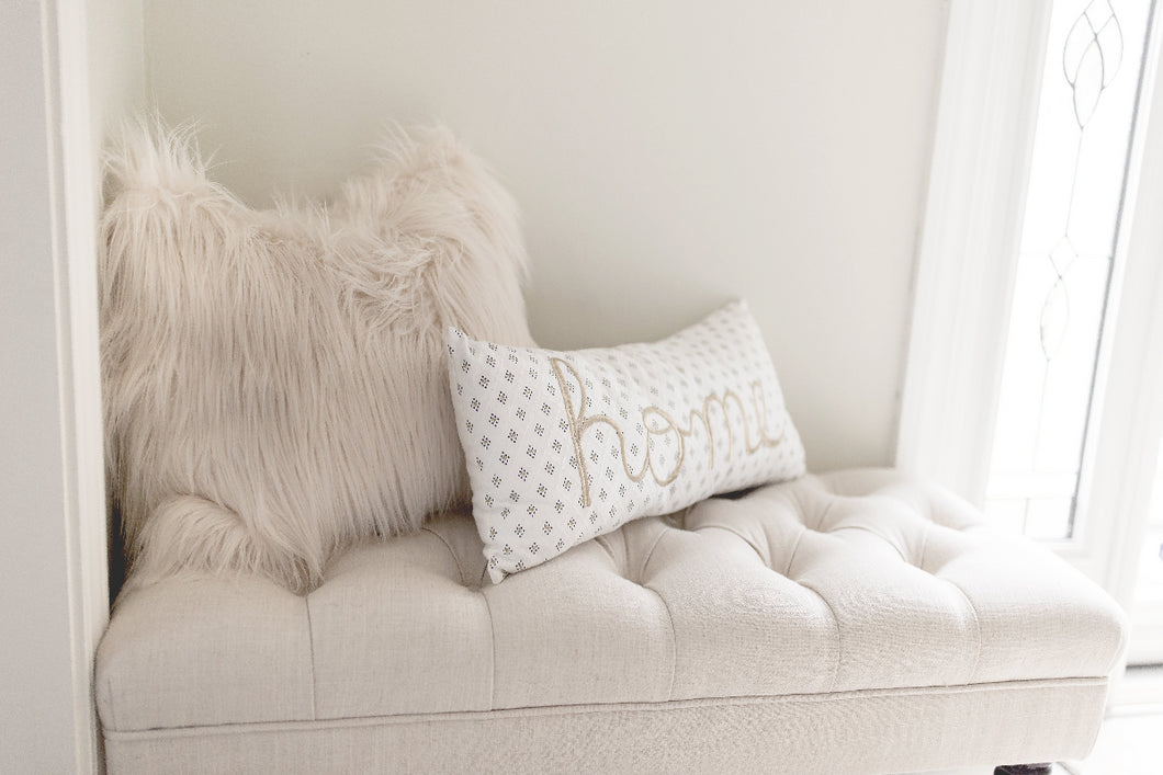 ivory cream faux sheepskin luxury fur pillow on bench in entrance to home