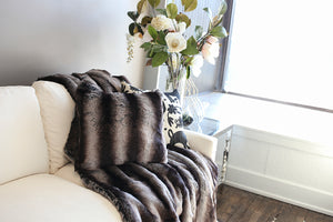 close up photo of black and gray or silver striped plush chinchilla faux fur throw and pillow. American made by FuRmanity