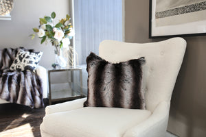 living room photo of black and gray or silver striped plush chinchilla faux throw blanket and matching pillow.  American made by FuRmanity