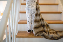 Load image into Gallery viewer, little boy dragging brown striped faux fur blanket up stairs