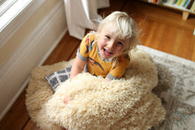 Load image into Gallery viewer, light yellow faux fur blanket by FuRmanity with little girl sitting on it