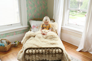 twin size faux fur comforter on little girl's bed