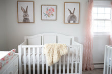 Load image into Gallery viewer, light yellow luxury fur blanket from baby shower gift draped over crib in nursery room
