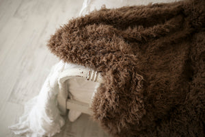 close up of thick and heavy, warm, brown faux fur blanket by FuRmanity on white bed