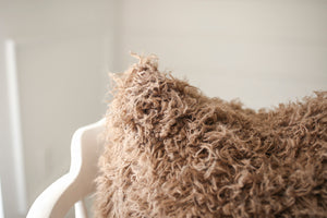 close up texture photo of medium brown luxury, american made, faux fur accent pillow