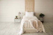 Load image into Gallery viewer, cool, off white, curly fake sheepskin vegan fur blanket on white bed