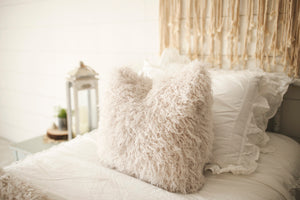 cool, off white, faux fur luxury accent pillow by FuRmanity on white bed