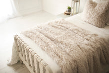 Load image into Gallery viewer, gorgeous white, curly faux fur blanket on twin bed.