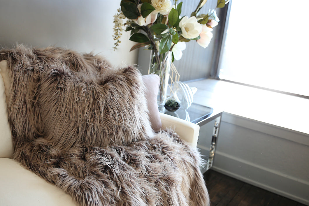 two tone luxury faux fur, double sided, throw with matching pillow on couch