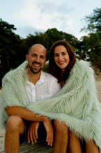 Load image into Gallery viewer, Couple's Photo Shoot with Pastel Green Vegan Fur Throw Blanket at the Beach | Fairy - Furmanity