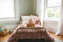Load image into Gallery viewer, little girl reading a book in bed on a pink faux fur blanket and pillow