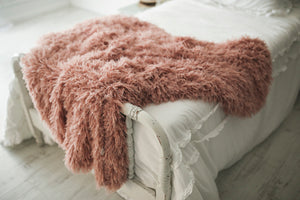 thick and heavy, weighted, pink faux fur throw blanket on girl's bed