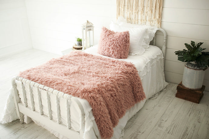 super soft, light pink, faux fur blanket and matching decor pillow
