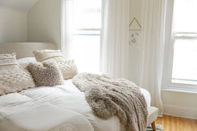 Load image into Gallery viewer, tan, faux fur, home decor blanket throw on bed with neutral interior decor