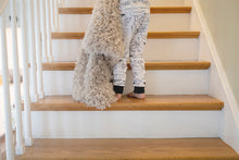 Load image into Gallery viewer, boy walking up stairs carrying tan faux fur children's blanket
