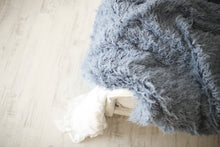 Load image into Gallery viewer, medium blue, luxury, fur blanket on corner of bed