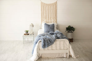 medium blue, luxury, fur blanket and matching pillow on white bed