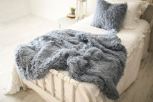 Load image into Gallery viewer, gorgeous, soft, denim blue faux fur blanket and matching pillow on bed