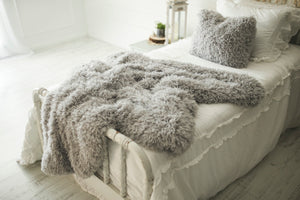 neutral light gray, luxury, double sided, faux fur decor pillow and throw blanket on white victorian bed