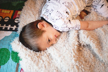 Load image into Gallery viewer, short gray or ivory faux fur blanket with kid cuddling on it