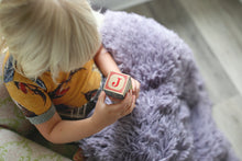 Load image into Gallery viewer, dusty purple faux fur little blanket for kids. girl playing with blocks with blanket