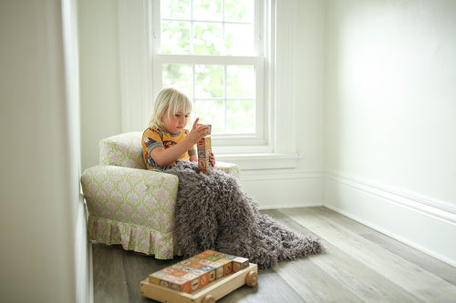 little boy or girl's small faux fur blanket in super soft texture. machine washable.