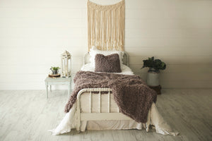 super thick and heavy, faux fur blanket with matching pllow on bed