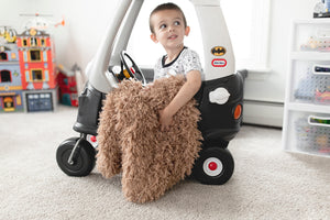 little boy in car with his faux fur kuddle blanket for kids hanging out. Luxury furs by FuRmanity
