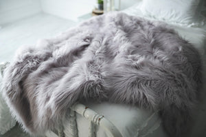 super thick and warm, luxury, vegan faux fur blanket on bed