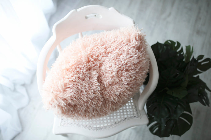 super soft, light peach, faux fur pillow on white chair. luxury decorative pillow by FuRmanity