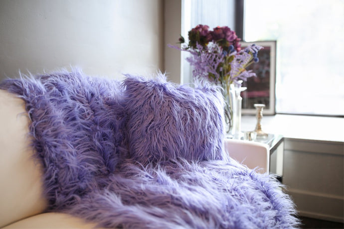 little girls purple faux fur blanket and matching cruelty-free pillow.