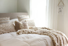 Load image into Gallery viewer, luxury neutral bedroom with light shining through window and faux fur animal print fabric pillow and blanket on bed