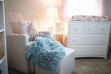 Load image into Gallery viewer, blue, green double sided, super warm and soft faux fur blanket in baby nursery, laying on chair.