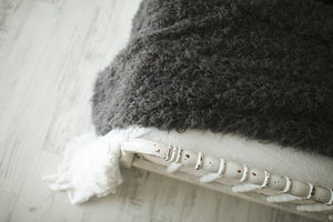 close up photo of eco-friendly faux fur blanket texture on bed