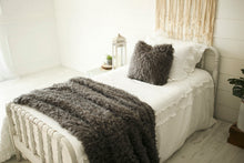 Load image into Gallery viewer, gorgeous, dark gray, handmade vegan faux fur pillow and throw on white bed