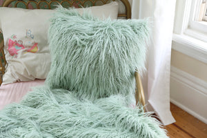 "18"" thick and wavy, faux fur, mint green pillow in girl's bedroom"