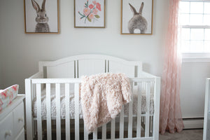 light peach luxury vegan fur throw in little girl's nursery room