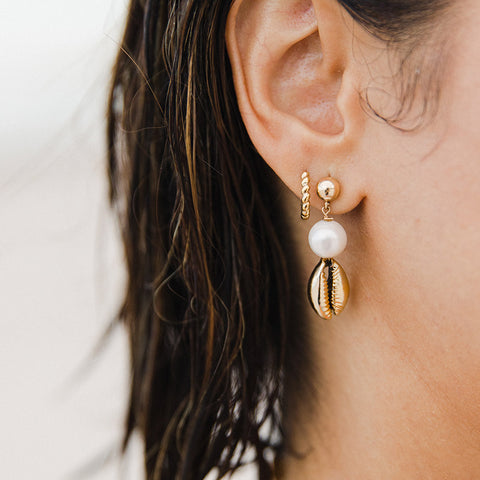 taudrey kelly saks capsule collection key biscayne earrings gold shell pearl detail drop stud
