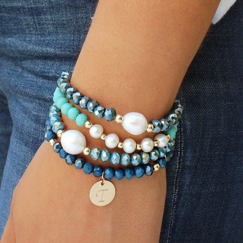 taudrey deep blue sea bracelet set shades of deep blue pearl details personalized gold charm