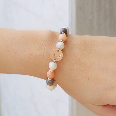 taudrey current mood beaded bracelet featuring warm tones and personalized rose gold charm