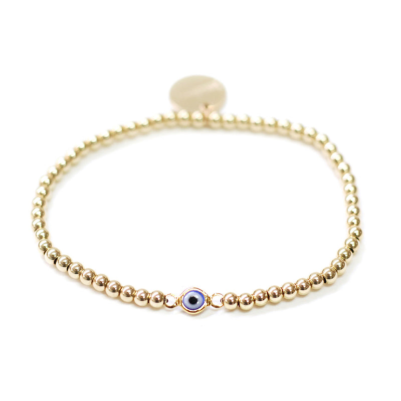 taudrey gold beaded bracelet evil eye charm