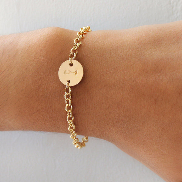 taudrey flip a coin gold chain bracelet personalized gold charm detail