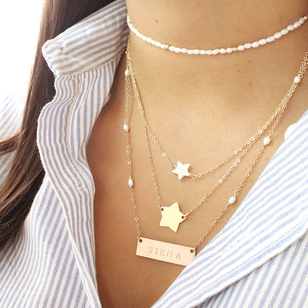 taudrey written in the stars necklace layered pearl star personalized gold star charm