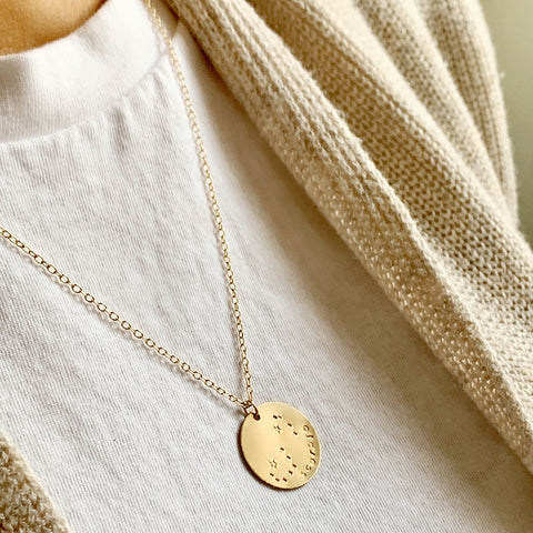 taudrey blogger collaboration piece Give me a sing necklace by Macarena Ferreira hand stamped zodiac constellation necklace