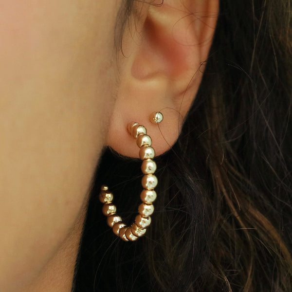 taudrey glimmer of hoop gold open studded hoop earrings