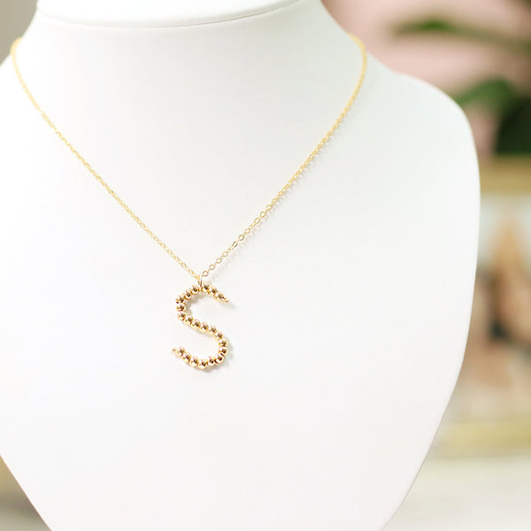 taudrey gold and bold beaded initial letter handcrafted necklace