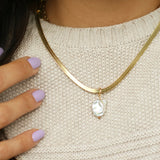 taudrey happy and you know it herringbone gold necklace naturally shaped pearl detail
